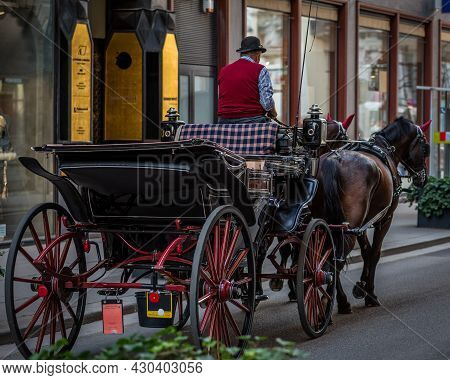 Horse-drawn Carriage In Old City, Two Horses Carriage Ride In Europe