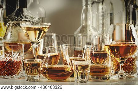 Strong Alcohol Drinks, Hard Liquors, Spirits And Distillates Iset In Glasses And Bottles: Cognac, Sc