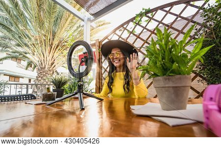 Happy Asian Woman Having Fun Doing Online Video Call Using Smartphone Cam And Influencer Led In Cafe