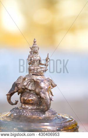 Deity Of God Indra Is Riding Erawan (airavata) Three Head Elephant, The Bronze Statue On Yellow And