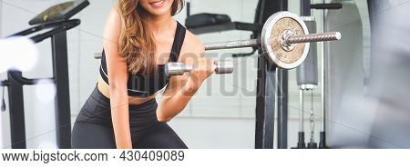 Sporty Woman In Sportswear  Exercising With Dumbbells.