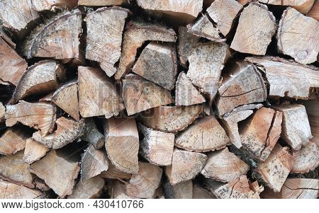 Wood Piles Of Firewood, Background From Dry Chopped Logs In A Heap - Image