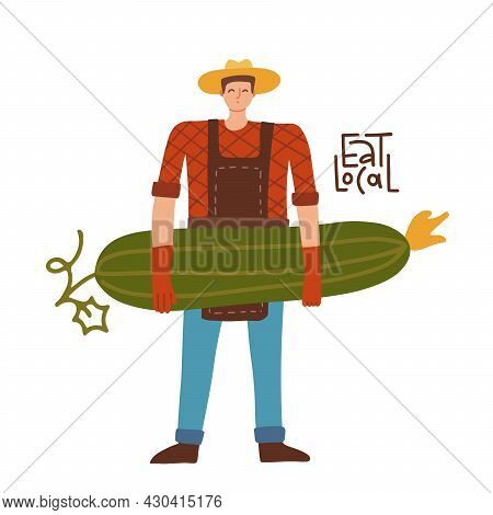 Young Farmer Man Carrying Big Cucumber. Male Gardener Character With Natural Organic Vegetable. Eat