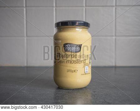 Sint Gillis Waas, Belgium, August 20, 2021, A Glass Jar Of Dijon Mustard Under The Brand Name Regalo