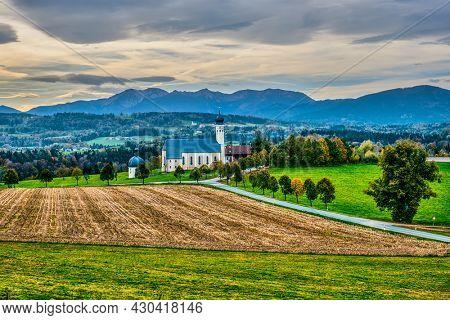 Biew of Bavaria autumn countryside rural scene - Pilgrimage church of Wilparting, Irschenberg village, Upper Bavaria, Germany