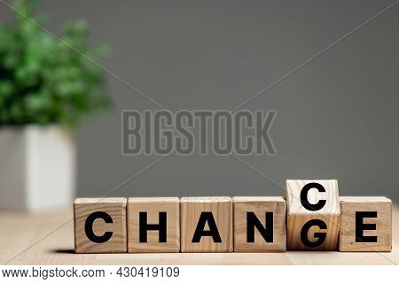 Wooden Cubes With Letters On The Table Transform Wording Change To Chance. Copyspace For Ad.