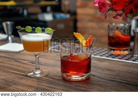 Tasty Long Drink On Bar Counter. Two Cocktails, Drinks For Man And Woman, A Romantic Date At The Bar