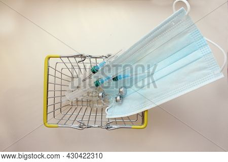 Basket With Ampoules Of Medicines For Injection, Spri, Medical Mask. Vaccination. The Concept Of Med