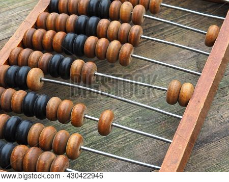 Vintage Wooden Abacus Close Up. The Concept Of Bookkeeping, Business Or Saving Money