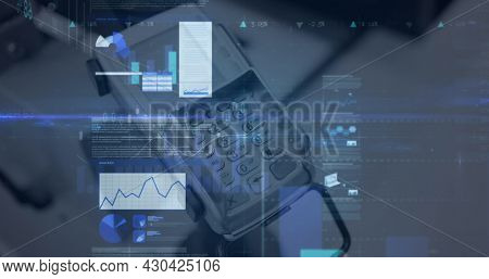 Image of financial data processing over credit card terminal. global finances, business and contactless payment concept digitally generated image.