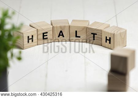 Six Wooden Cubes, Blocks Standing On Table And Showing Word Health. Conceptual Image About Human Rig