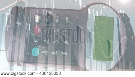 Image of financial data processing over payment terminal. global finances, business and contactless payment concept digitally generated image.