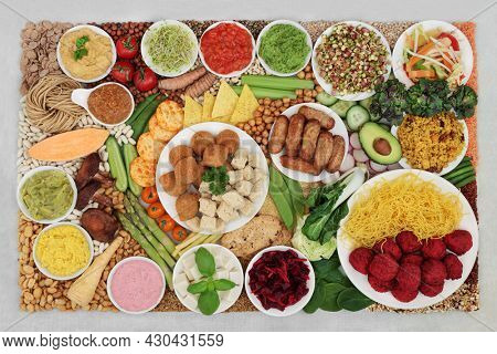 Large vegan health food collection for ethical eating, high in antioxidants, protein, omega 3, dietary fibre, anthocyanins, smart carbs, vitamins, minerals, lycopene. Natural health care concept.
