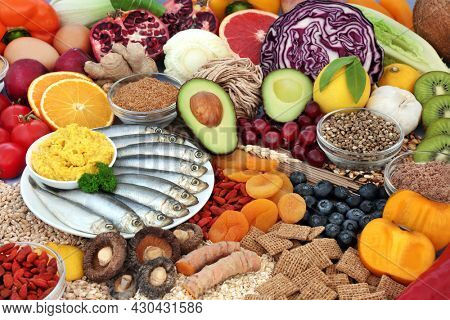 Healthy immune system boosting low cholesterol food high in antioxidants, protein, omega 3, vitamins, minerals, lycopene, anthocyanins, fibre. Natural health care concept.