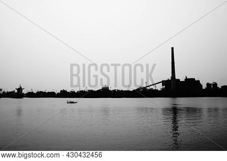 Ganges River In Black And White With Industrial Background, High Contrast Image,