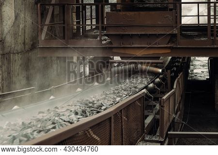 Conveyor Belt Transports Hot Briquetted Iron. Metallurgical Plant Area. Speedy Moving Process.