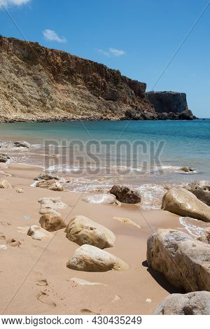 Rocks On An Empty Beach With No People, Sunny Day. Sagres, Algarve, Portugal, Europe