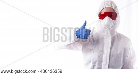 A Woman In A White Chemical Protection Suit Shows A Thumb On A White Background, Disinfection, Pest