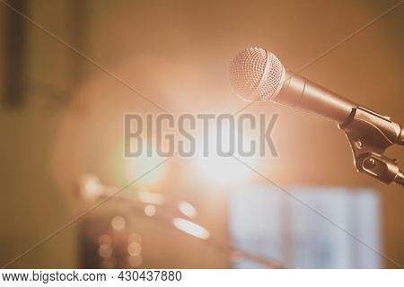 Microphone On Stage Without Speakers In The Beams Of The Spotlight, Bright Light On The Stage
