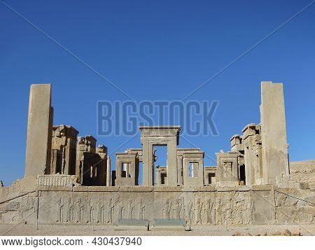 Remains Of Main Building Of Persepolis, Palace Of Xerxes, Persian King. Walls Are Decorated With Wea