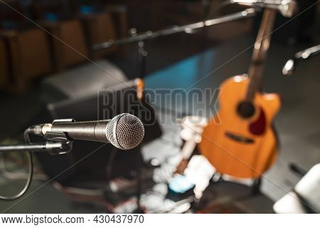 Electric Wired Microphone On An Empty Stage Without Musicians. Musical Equipment For Performing On S