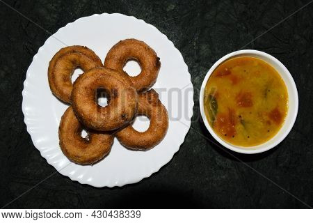 Topview Of Popular Dish Item South Indian Mendu Wada And Sambhar Served On Marble Table. Restaurant