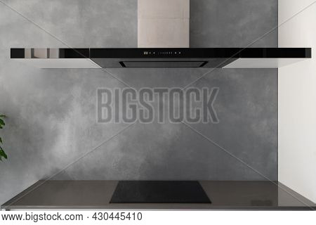 Counter With Built In Black Glass Induction Cooktop With Electric Hood Exhaust Above, Integrated Kit