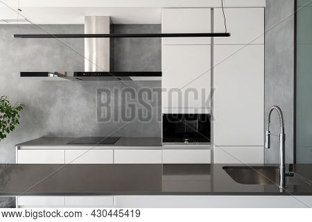 Beautifully Appointed Modern Kitchen With Various Furniture, Built-in Appliances, Counter With Sink
