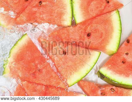 Slices Of Melon In Water On White Background. Melon Close-up In Liquid With Bubbles. Slices Of Red R