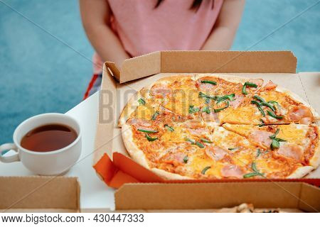 Unhappy Young Woman Looking At Pizza In Pizza Box. Diet For Adult And Refusing From Gluten, Wheat Fl