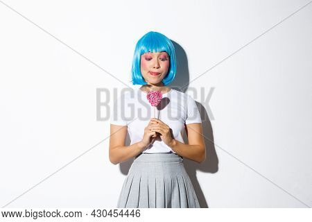 Portrait Of Silly And Cute Asian Girl Celebrating Halloween In Blue Short Wig And School Uniform, Lo