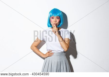 Image Of Silly Beautiful Asian Girl In Blue Short Wig And Kawaii Makeup, Shushing At Camera As If Sh