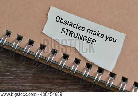 Notebook And Torn Paper Written With Obstacles Make You Stronger