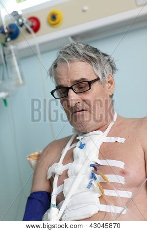 Patient with bandage on his chest after heart surgery poster