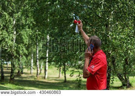 Minsk. Belarus- 25.07.2021 - Man Signals The Start Of A Golf Tournament. High Quality Photo