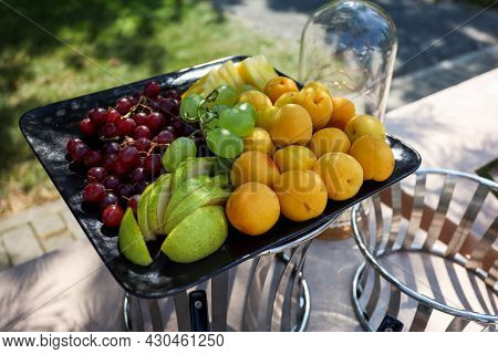 Fruit Buffet In The Square Black Tray.