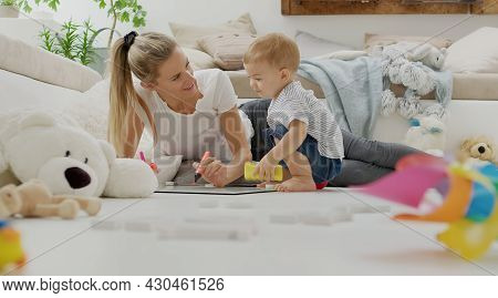 Happy Smiling Mom Plays With Her Baby, With Colorful Pens Markers And Whiteboard, Educational Learni