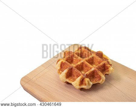 Round Waffle, A Close Up Of Traditional Homemade Delicious Crispy Waffle Cake Dessert Isolated On Wh