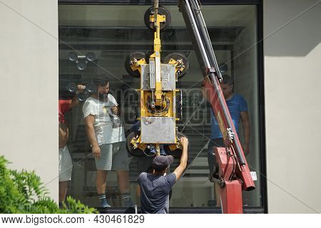 Bucharest, Romania - August 12, 2021: Workers Install A Very Large Double-glazed Window With A Mobil