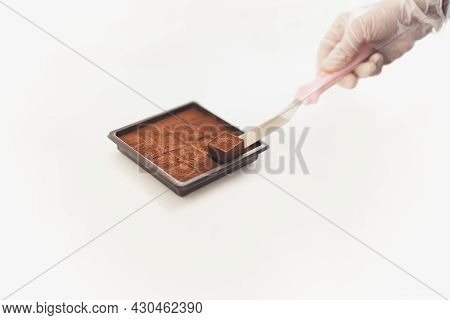 Chef Hand With Glove Packing Nama Chocolate Into A Boxes.