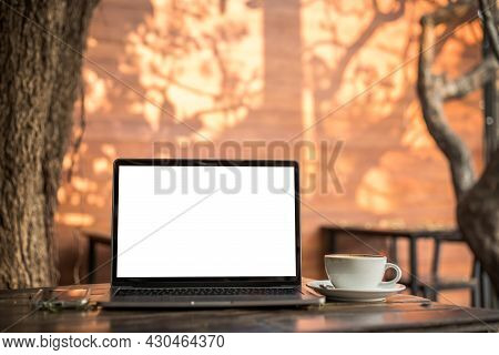 Mockup Of Laptop Computer With Empty Screen With Coffee Cup And Smartphone On Table Of Tree Branch S