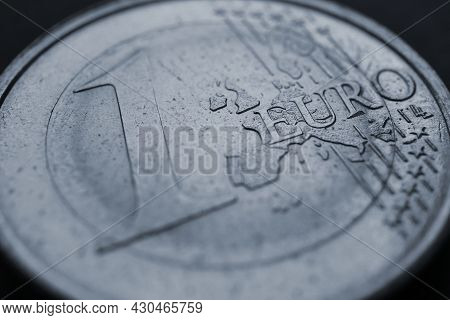 Fragment Of A Coin Of 1 One Euro Close Up. In Focus Inscription With The Name Of The Eurozone Curren