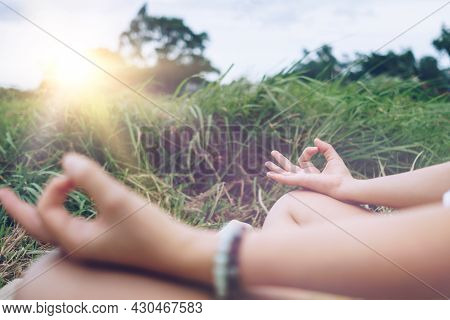 Woman Practicing Yoga Lesson, Breathing, Meditating Exercise, Outdoor In Grass Field. Well Being, We