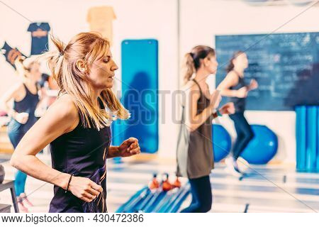 Close Up Of Women Doing Aerobic Exercises In Health Club