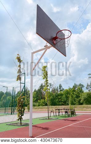 Basketball Pole With A Basket In An Stadium Outdoor. Vertical View. Low Angle View