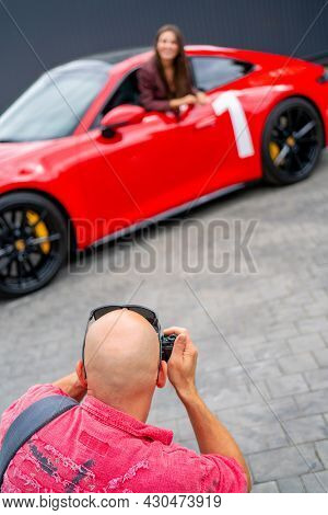 Moscow. Russia. August 13 2021 Photographer And Red Car. Professional Photo Session Of A Red Car. Th