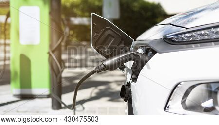 Close Up Of Electric Car Charging Battery. Ecological Hybrid Vehicle Charger. Concept Of Sustainable