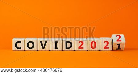 Symbol Of Covid-19 Pandemic In 2022. Turned A Wooden Cube And Changed Words 'covid 2021' To 'covid 2