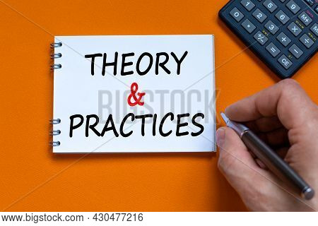 Theory And Practice Symbol. Businessman Writing Words 'theory And Practice' On White Note. Black Cal