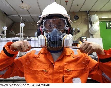 Multi-purpose Respirator Half Mask For Toxic Gas Protection. The Man Prepare To Wear Multi-purpose H